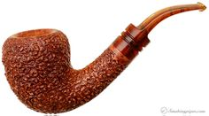 This one looks like Cocoa Crispies.  Rinaldo Lithos Bent Acorn (YY) Pipes at Smoking Pipes .com