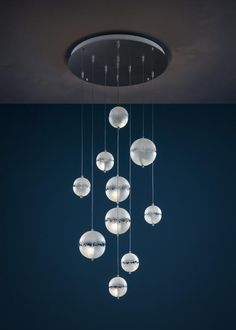 The Catellani & Smith Postkrisi Chandelier is a chandelier with three, five, seven or ten lights. Each light consists of two composite hemispheres which are made of natural-coloured fiberglass. Entry Chandelier, Chandelier Lighting, G4 Led, Loft Interior Design, Loft Interiors, Light Installation, Lighting Design, Lighting Ideas, Lights