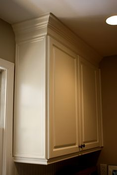 Finished cabinets using Benjamin Moore's Aura self-priming paint