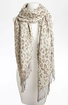 """Lulu leopard scarf at Nordstroms Tonal leopard spots prowl across a lightweight scarf sprinkled with subtle shimmer.      Approx. dimensions: 27 1/2""""W x 70""""L with 3 1/2"""" fringe.     BP.     Polyester; hand wash.     By Lulu; imported."""