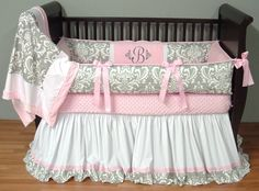 Brooklyn Silver Damask Bedding  This custom 3 pc baby crib bedding set includes a luxury plush detailed bumper pad, long flowing trimmed crib skirt, and so soft pink minky edged and backed blanket.  Designer silver and white damask, pink grosgrain ties, soft pink and white pique, and ultra soft pink minky combine softness and textured detail.