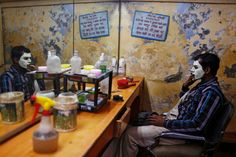 Anindito Mukherjee - Reuters, Dec. 31, 2013. A migrant laborer, his face covered with facial cream, smokes as he waits for the cream to dry at a barber shop in New Delhi, India.
