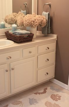 Brown bathroom decor · tempted to paint the oak bathroom vanity a nice creamy white & add hardware like this Old Bathrooms, Amazing Bathrooms, Oak Bathroom Vanity, Master Bathroom, Bathroom Cabinets, Small Bathroom, Paint Vanity, Warm Bathroom, Bathroom Beadboard