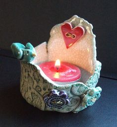 ceramic tea light holder with bird, heart and two flowers