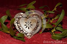 Photo about Golden heart and mistletoe on red background. Image of plants, love, valentines - 83149709 Golden Heart, Heart Of Gold, Photo Gold, Red Background, Mistletoe, Valentines, Brooch, Image, Jewelry