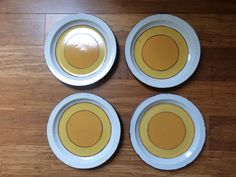 Sold!  Check out this other set https://www.etsy.com/listing/455027654/four-mikasa-duplex-duet-dinner-plates-by?ga_search_query=yellow+plates&ref=shop_items_search_2 by ChicAvantGarde on Etsy