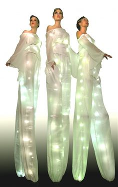 Light Walkers glowing white stilt walkers for corporate events from entertainment agency Sternberg Clarke