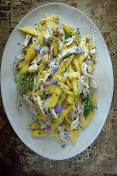 Mango Chicken Salad with Honey Lime Dressing 8 ounces cooked chicken breast, shredded 1 mango, peeled and cut into thin strips 1 shallot, julienned 2 tablespoons chives 2 tablespoons olive oil 2 teaspoons honey (or agave) 1 lime, zested and juiced kosher salt and pepper