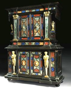Mid-19th century Italian, Baroque Revival style, ormoulu-and-hardstone mounted ebonized cabinet, probably Florentine, as it being mounted with a great variety of hardstones including onyx, lapis lazuli, red griotte, campan pink and green, Sienna, tiger blue, and sarrancolin, certainly reminds us of the great Tuscan Republic, the Medici's, the Tornabuoni's; alliances and betrayals, all posed with even more science than even dignity.