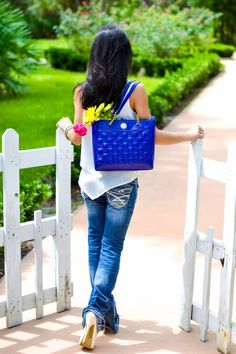 White picket fence. At the garden, fashion style blue purse Anne Klein flare jeans