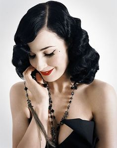 Dita Von Tese...I love her old school looks, she always dresses (when she has clothes on) like a lady!