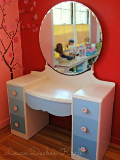 Thrift store dressing table, drawers painted in graduated shades of blue.
