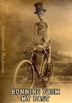 2100f0049 Creepy vintage Halloween photo of a skeleton riding a bicycle.