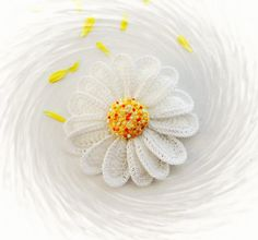 This lovely Daisy Marguerite Brooch hand crocheted with white, yellow acrylic, white cotton yarn and adorned with beautiful seeds beads.   The flower measures approx: 13,5 cm in diameter  The brooch has a silver plated pin fastener, so can be easily attached to your hat, blouse, dress, jacket...  Looks lovely on summer straw hat or bag.  Light wear and unique, made with love and care, with great attention to detail from start to finish in a smoke free environment.