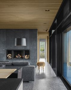 A Timber-and-Concrete Summer House in Iceland Boasts Breathtaking Views #concrete #vacationhome #iceland #hometour #fireplace #livingroom