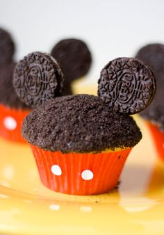 Mickey Cupcakes  1 box cake mix  1 can frosting  1 package regular oreos  Toothpicks  Red cupcake liners  Punches from a whole-puncher