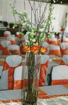 Green Bride Redux: Simple (for real) DIY centerpieces. Birch twigs and bicolor orange roses. greenbrideredux.blogspot.com