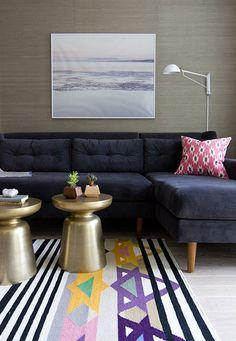 gray sofa + gold tab