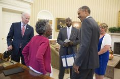 President Barack Obama and Vice President Joe Biden welcome 97-year-old Vivian Bailey and her guests, Principal Troy Todd and teacher Melissa Peyton, to the Oval Office, May 26, 2015. Ms. Bailey has been raising money for more than a dozen years so students of Running Brook Elementary school in Columbia, Maryland, can take field trips. (Official White House Photo by Pete Souza)
