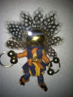 Miniature kachina made from a plastic army figure and  mismatched or broken jewelry