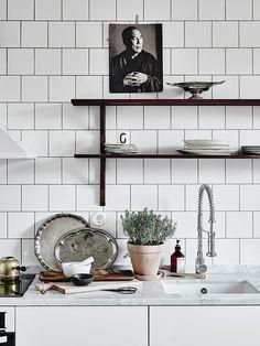 white tiled kitchen.