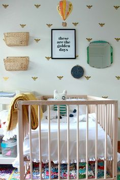 Quirky neutral nursery. Love the bee wallpaper