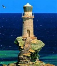 A place I'd like to see - islands off the coast of Greece - photo: Tourlitis Lighthouse, Andros Island. Makes you aware how much the coastline has been worn away by weather & sea & changed by the centuries (a guide). Pays Europe, Animal Original, Greece Art, Lighthouse Pictures, Lighthouse Keeper, Lighthouse Art, Am Meer, Water Tower, Greek Islands