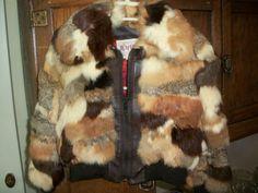 Rabbit fur. I swear I had a coat just like this.. somewhere around 1984 or '85ish!