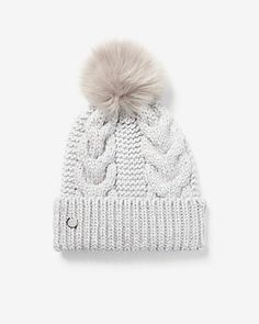 6cfe532d496 Keep cozy in this cable knit beanie with metallic threading and a soft pom  on top