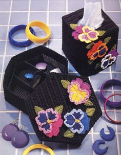 These two patterns are for a Jewelry Box and a Tissue Cover that you can stitch using 7- and 10-count plastic canvas, worsted weight yarn