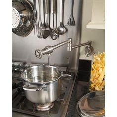 The Steam Valve Original wall mounted pot filler (also available as a deck mount), is both stylish and functional. Manufactured from solid stainless steel. Kitchen Stove, Kitchen Taps, Kitchen Fixtures, Kitchen Aid Mixer, Kitchen Redo, Kitchen Design, Pot Filler Faucet, Bathroom Taps, Steam Valve
