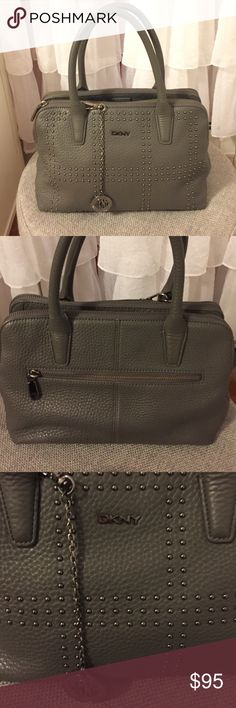 DKNY Grey Leather Bag with shoulder strap Very gently used in mint condition. Includes shoulder strap (detachable) and original dust bag. Two zipper compartments and additional zipper compartment on back (as pictured). Zipper compartment inside bag as well as mobile phone pocket. Measures 12 inches wide and 8 inches high (not including handles) DKNY Bags Shoulder Bags
