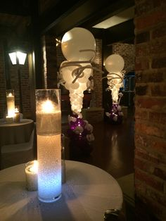 Balloon column with LED light, centerpiece with candle,LED lighting and gel www.dreamarkevents.com