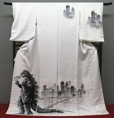 The infamous Godzilla kimono.  It's been reposted so many times that I'm not sure anyone remembers its source- beyond it being YJA- but it needs to be reposted again and again.  Because it, along with the Shark Attack Kimono, is a Weird Wafuku legend.  No collection on the topic would be complete without it. by graciela