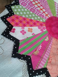 am also in love with the Dresden so I decided to combine the two and made a happy Dresden flower! I stitched-in-the-ditch between the blades on black wool felt and black/white polka dot fabric and then used pinking sheers to cut away from the edge.