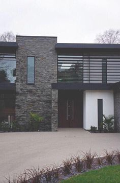 Inspiring Display of Natural Textures Nairn Road Residence in Dorset, England is part of Facade house - Designed by David James Architects in Dorset, England, Nairn Road Residence displays a sober modern exterior appearance Casas Containers, Facade House, House Facades, House Exteriors, Modern Exterior, Stone Exterior, Wall Exterior, Stone Facade, Grey Exterior