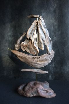 ...What a lovely driftwood boat.....vwr