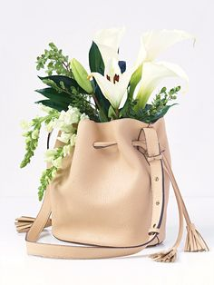 Love this idea from Free People. Flowers and Purses, Oh my! Bleeker Bucket Bag, $68.00