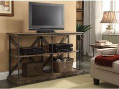 Rustic and bold, this media console has the natural charm of reclaimed wood. Finished in a warm and neutral Corbin Medium Brown, it has a slab top, balanced with a slab-style base, both with beveled edges.