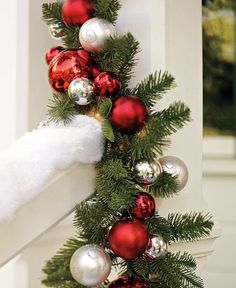 Add ornaments to a garland for added shine and color.