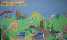 Children have helped create a colourful dinosaur scene, inspired by a term topic all about dinosaurs.