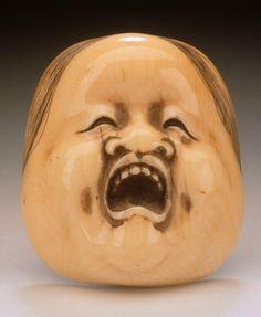 Yamaji Mitsuyuki (Japan)   Okame Mask, 19th century  Netsuke, Ivory with staining, sumi,