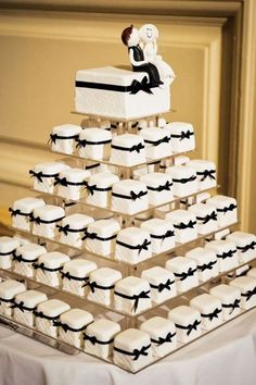Wedding Food Fancier than cupcakes but more portable than cake, these mini cakes are the perfect compromise. - Cakes and cupcakes aren't the only desserts that can be served in tiers! Get inspired by these fun ideas Fancy Wedding Cakes, Wedding Cakes With Cupcakes, Wedding Cake Designs, Wedding Desserts, Cupcake Cakes, Wedding Decorations, Mini Cakes, Cup Cakes, Cupcake Ideas