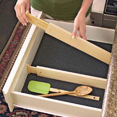 Spring-loaded drawer dividers.