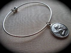 Silver bangle bracelet with Guardian Angel by HeidiDiCesareDesigns, $14.00
