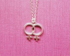 This product is a chain necklace with a double venus (lesbian or wlw) charm. The…