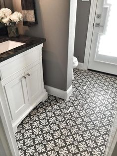 """I decided to do something fun in here with the tile. When I saw this black and white tile by Stone Peak Ceramics, I was sold! It's the perfect playful rustic tile for this small bathroom."" The black and white tile is "" Stone Peak Ceramics Palazzo Florentina Deco Tile""."
