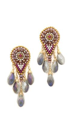 Dangling crystals and miyuki seed beads lend brilliant sparkle to these Miguel Ases earrings. Post closure.  14k gold fill. Made in the USA.  Measurements Length: 2in / 5cm $216.00