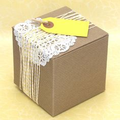 small brown box with doily string and tag