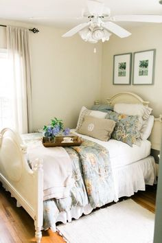 wall and bed paint .    Check out the timeless decor throughout this Southern cottage